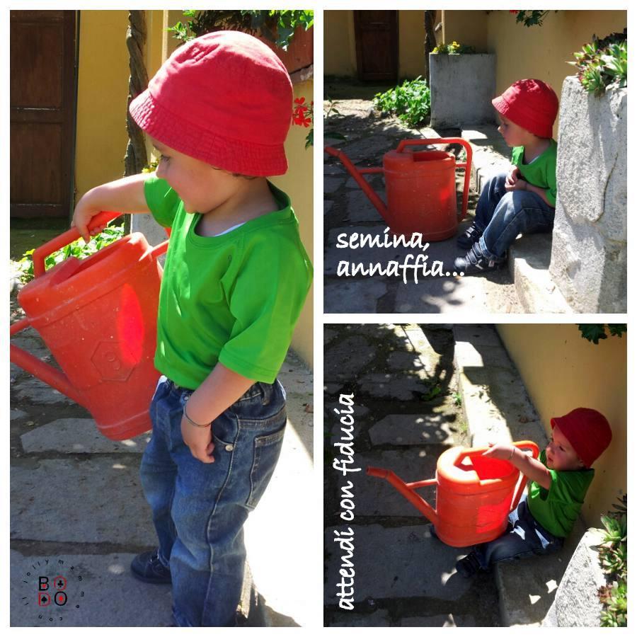 bimbo che bagna i fiori